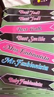 Sashes for the winners at a teen fashion show as party of the birthday games