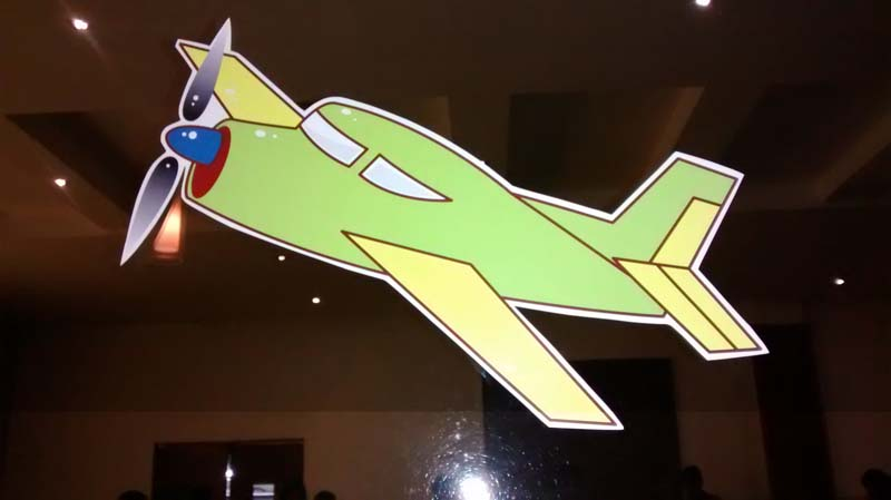 Toy green plane with yellow wings