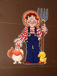 Farmer with hen and duck