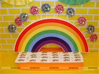 Candy counter setup for lolly pops for kids on a rainbow