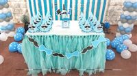 Cake table with a Blue Tutu table cover, Personalised hats and No 1 Little Man piece