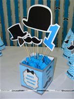 Box type Little Man center pieces with bow tie, Mush, No 1 and hat toppers. Baby name personalised on the box.