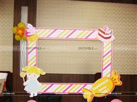 A candyland photo booth to entertain your guests at the party